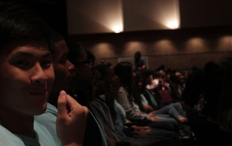 Vinson Huang catches the camera as the rest of GRHS Student Council members listen to the speaker.
