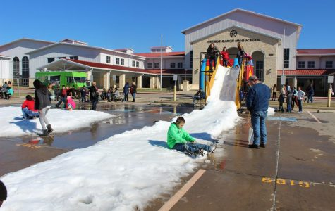 The Winter Wonderland at the Ranch is complete with imported snow, snow slides, and bouncy castles.