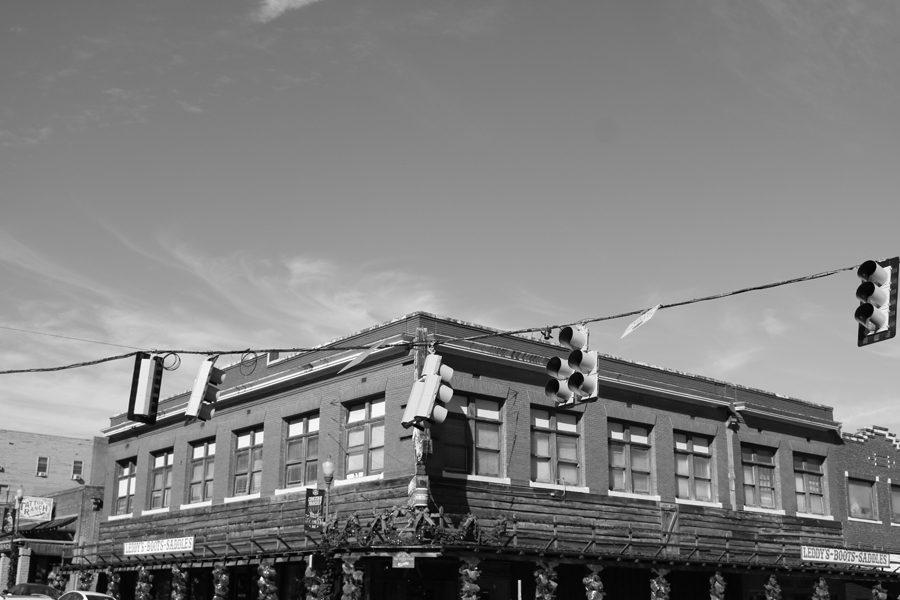 Streetlights hang over the western street