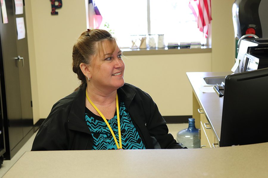 Nurse Vivian speaks to a student in her office