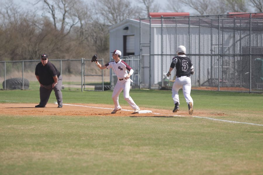 First Baseman Cole McMillan receives a throw to get an out at first