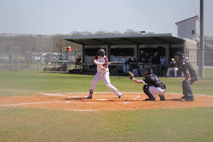 Designated Hitter Joseph Menefee swings at a high fastball