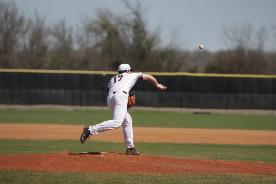 Pitcher Jacob Surratt throws a pick off to first