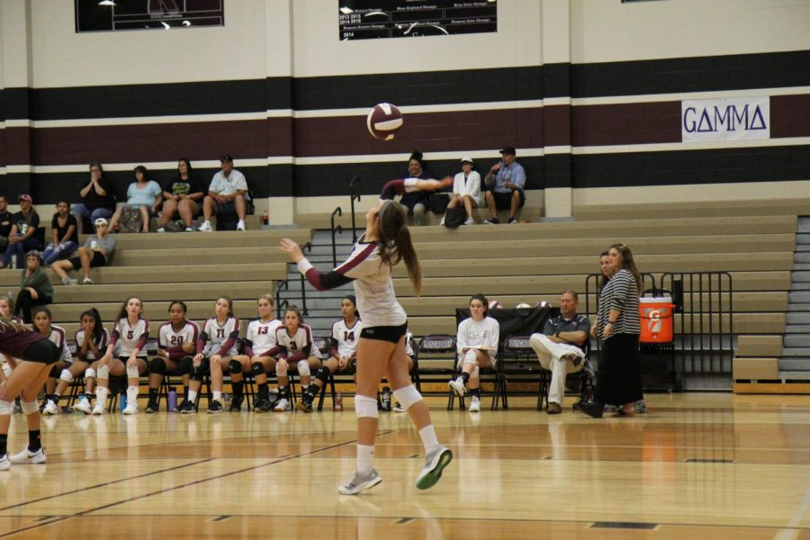 Avery Webb (9) serves the ball to Foster.