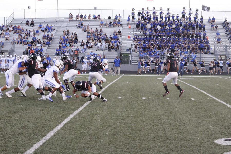 Christian Jackson (12th grade) looking for the open man to throw the ball.