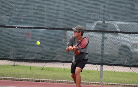 Nicolas Heard (12) hits the ball to his opponent.