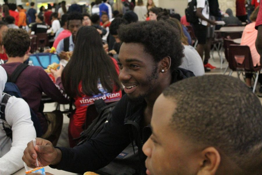 Deandre Murphy (11) listens to his friends at lunch.