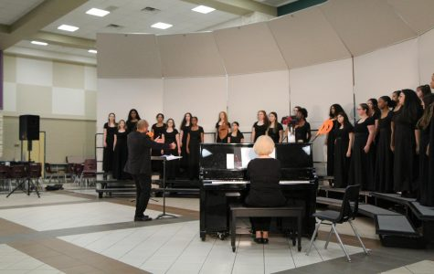 Varsity chorale and Mr. Williams conducting.