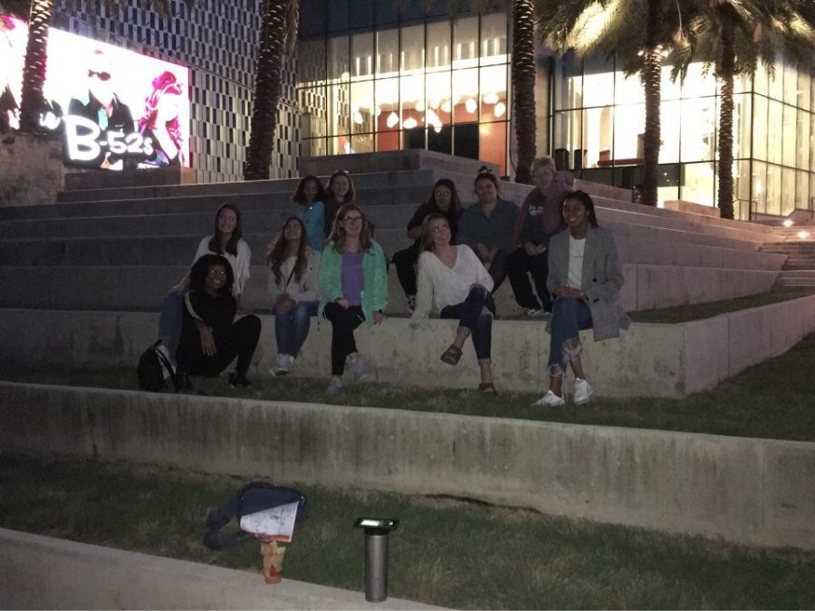 The editors and Mrs. Kroeker in front of a museum.