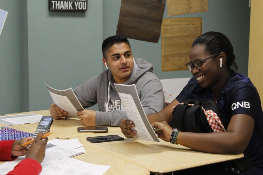 Danielle Dunk & Ibbi Sheikh (12)  laughing Ms. Harvey's class.