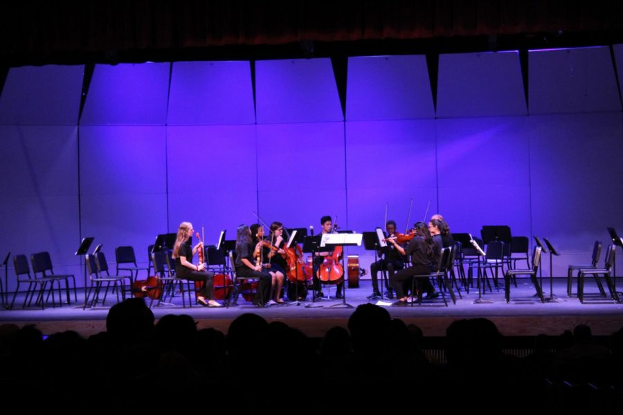 Orchestra students preforming a piece for their first concert.
