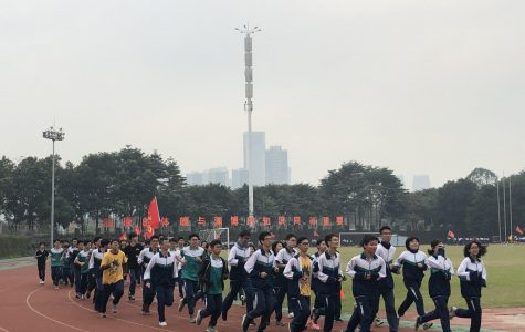 For morning exercise, the students of Foshan No. 3 Middle School run laps around the school track.