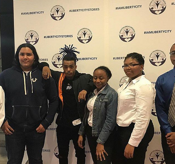 XXXTentacion (pictured middle left) partnering with the Miami Children's Initiative on March 16th, 2018.