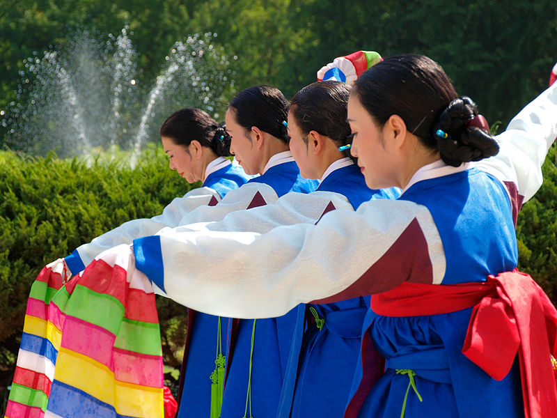 Dancers stand poised and ready as they perform a traditional Korean sword dance.