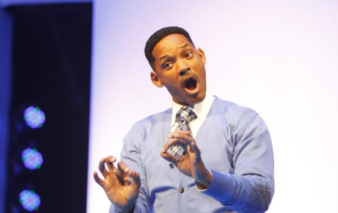 Will Smith shows off his naturally charismatic nature as he speaks at the 2011 Walmart Shareholders Meeting.