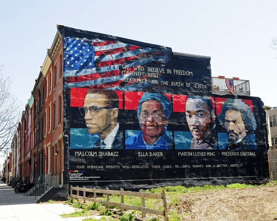 Mural on the wall of row houses in Philadelphia. The artist is Parris Stancell, sponsored by the Freedom School Mural Arts Program. Left to right; Malcolm Shabazz (Malcolm X), Ella Baker, Martin Luther King, Frederick Douglass. The quote above the pictures,We Who Believe in Freedom Cannot Rest, is from Ella Baker, a founder of SNCC (Student Non-Violent Coordinating Committee), a civil rights group. which amongst other contributions, helped to coordinate Freedom Ridesin the early 1960s.