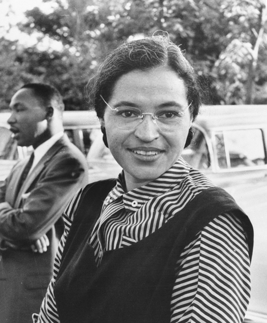 Rosa Parks with Martin Luther King Jr. in the background.