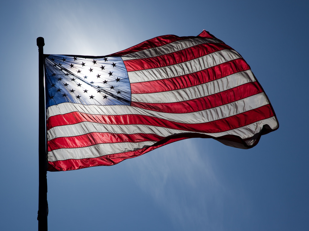 An American flag blowing in the wind