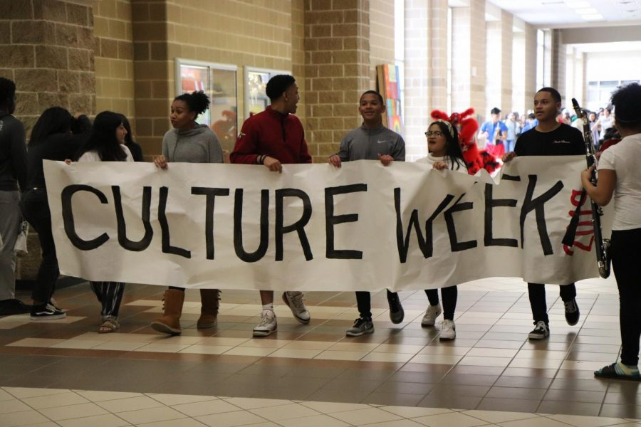 NHS members leading the Culture Parade with the Culture Week banner.