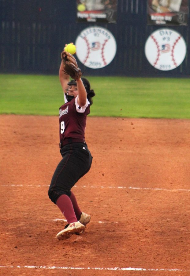 Natalie Zamora (10) using all her power to try to out pitch her opponents batter.
