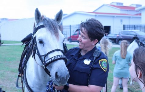 Another female officer and her horse.