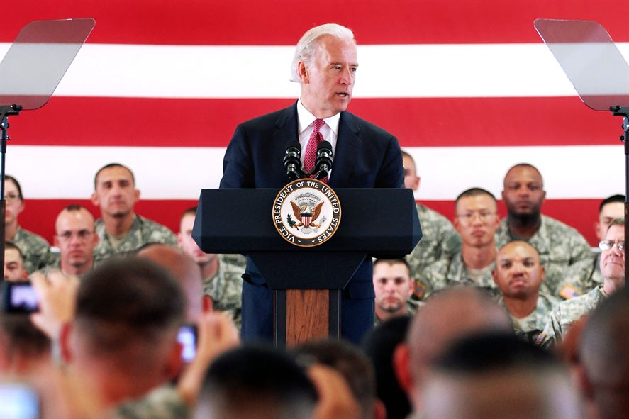 Joe+Biden+giving+a+speech+about+the+soldiers+in+the+background