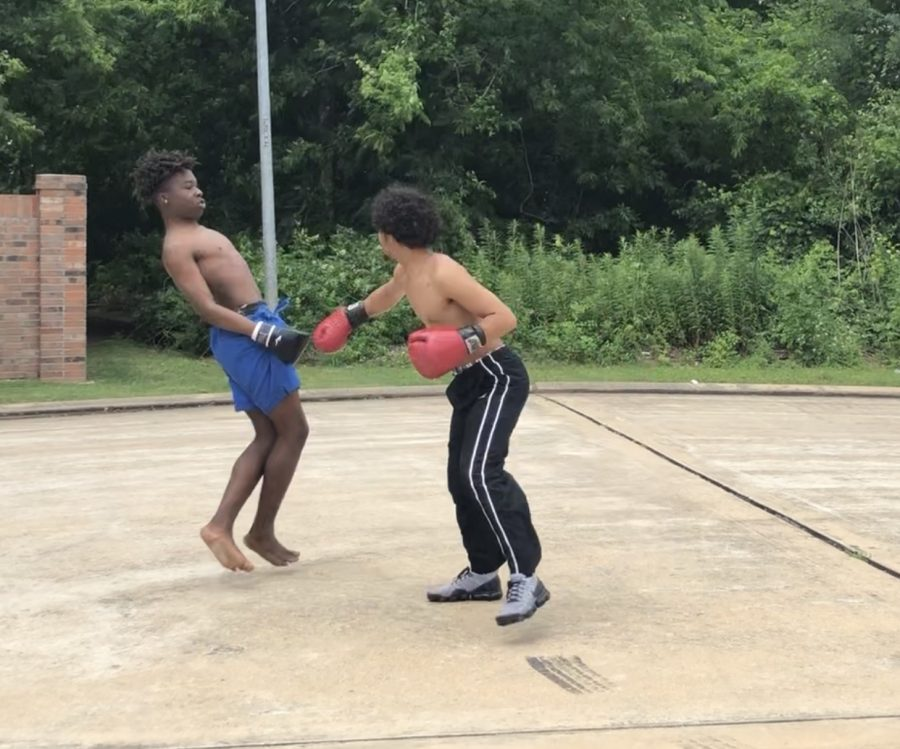 Outside+of+my+house+boxing+my+friend%2C+Rhaman+Anifowoshe.