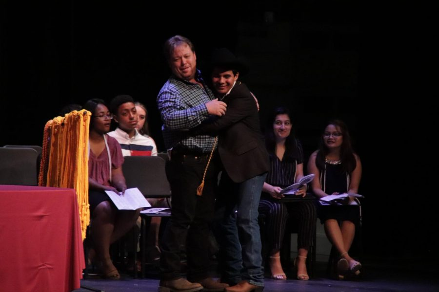Raul Zepada (12) giving one last hug to his Agriculture teacher, Mr. Brown.