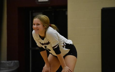 Mikayla Sutton (10) smiling back at her teammates after a great play.