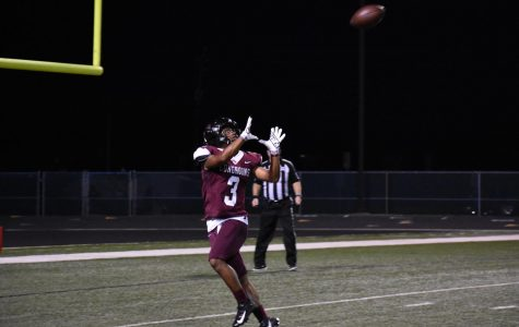 Andre Falkquay (12) completing a pass to make a touchdown.