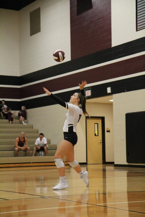 Riley Steubing (9) is getting ready to serve a hard pass to the libero.
