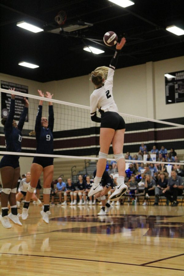 Avery Shimaitis (2) serving the ball straight to the Brazoswood back row receivers.