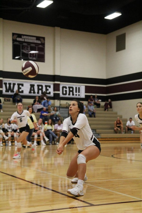 Elyssa Giries 11) is popping the ball to the setter of the team.