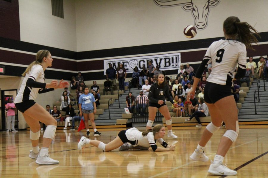 Mikayla Sutton (10) is diving for the ball trying to save it before it hits the ground.
