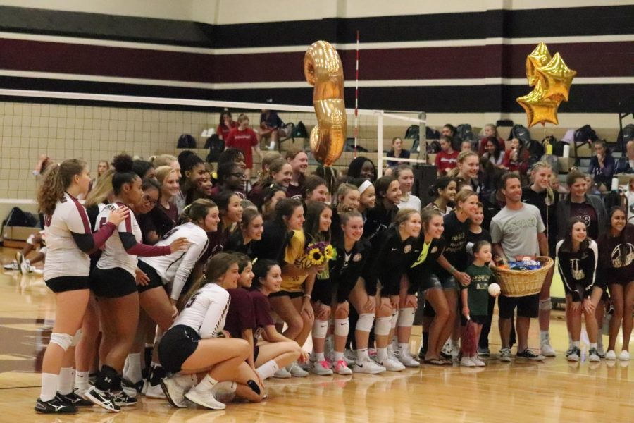 the volleyball teams come together to show support for child cancer