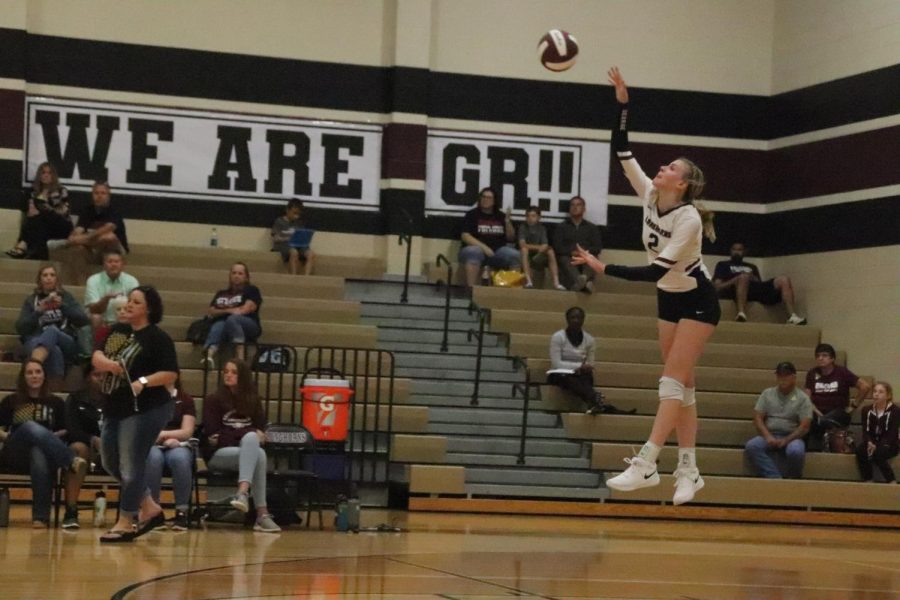 Avery Shimaitis going for a jump serve hoping to gain a point.