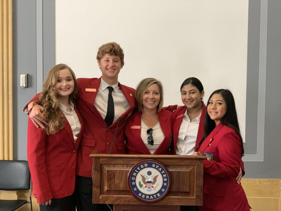 (Left) Emma Heintz, Tanner Hill (11), April Schmidt (11), Asma Shahzad (12), and Kaitlyn Rodriguez (11) standing at the podium where they met Senator Ted Cruz during their Texas Tuesday Coffee with Cruz.