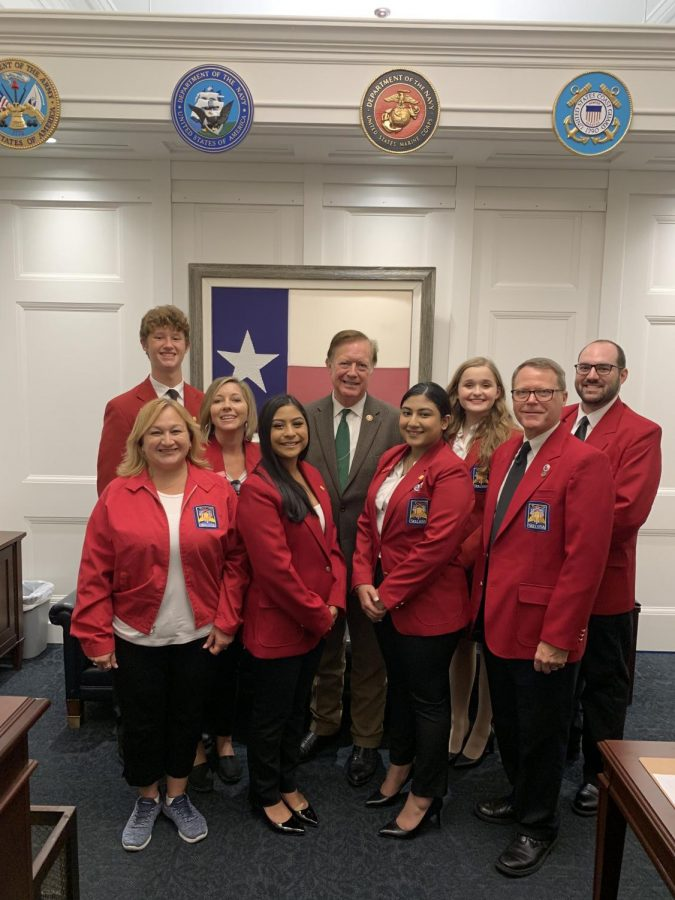 SkillsUSA members and advisors standing with Congressman Randy Webber at the Congressional Meeting.