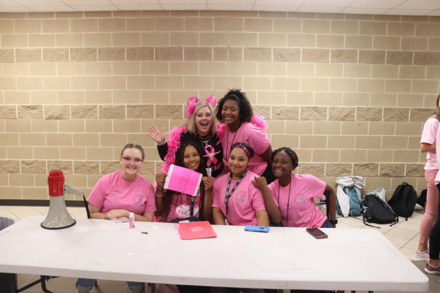 Ms.Patterson selling tickets for the pink out pep rally