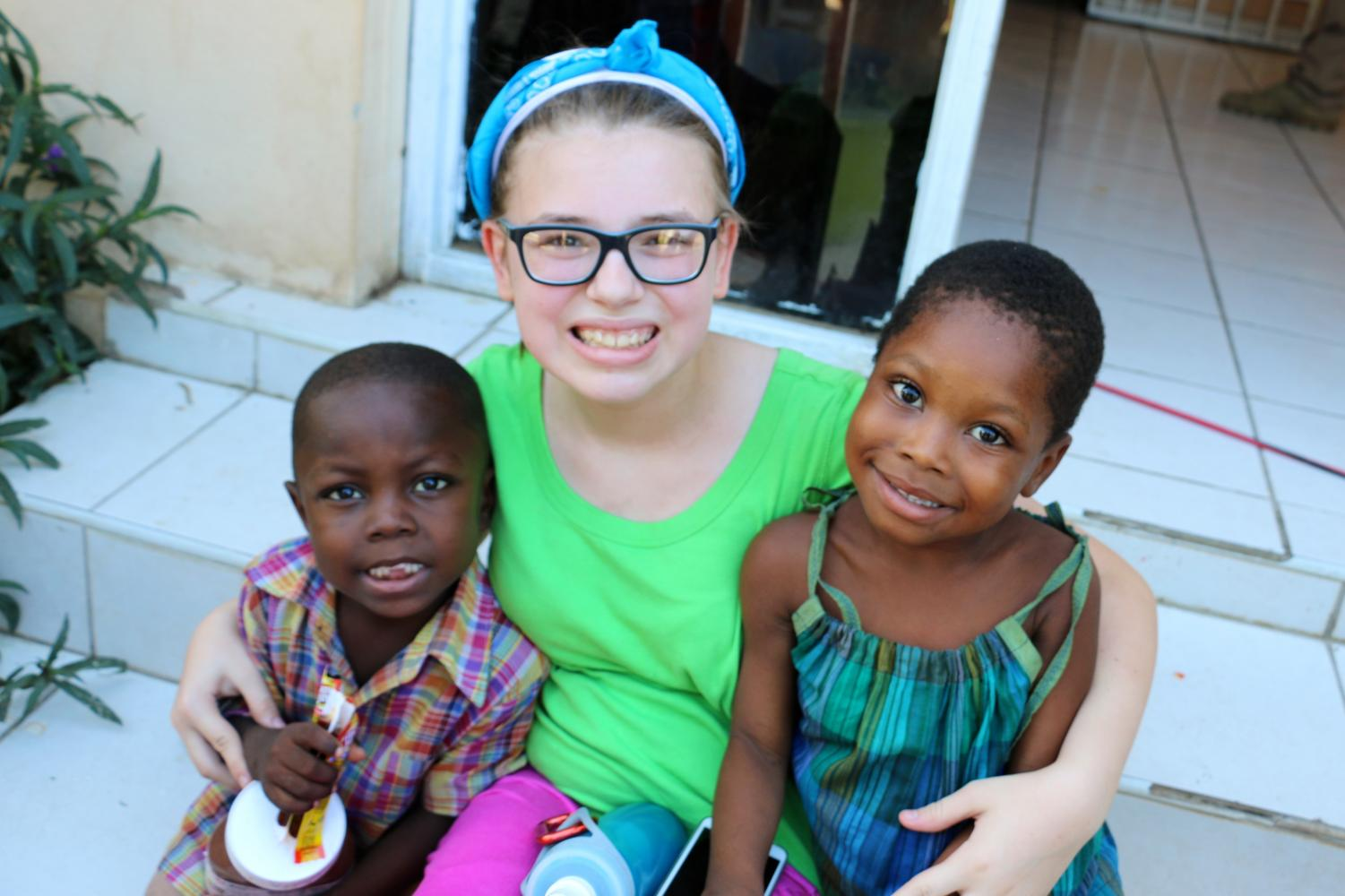 Nicole dencklau with Haitian orphans,Jerry and Esther during her trip to Haiti.
