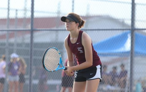 Elaina Ingelmo (9) keeps her eye on her opponent, waiting for he rnext move. This is Ingelmo's first year on the tennis team!