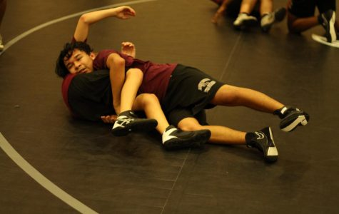 Colby Duran gaining the upper hand and pinning his opponent.