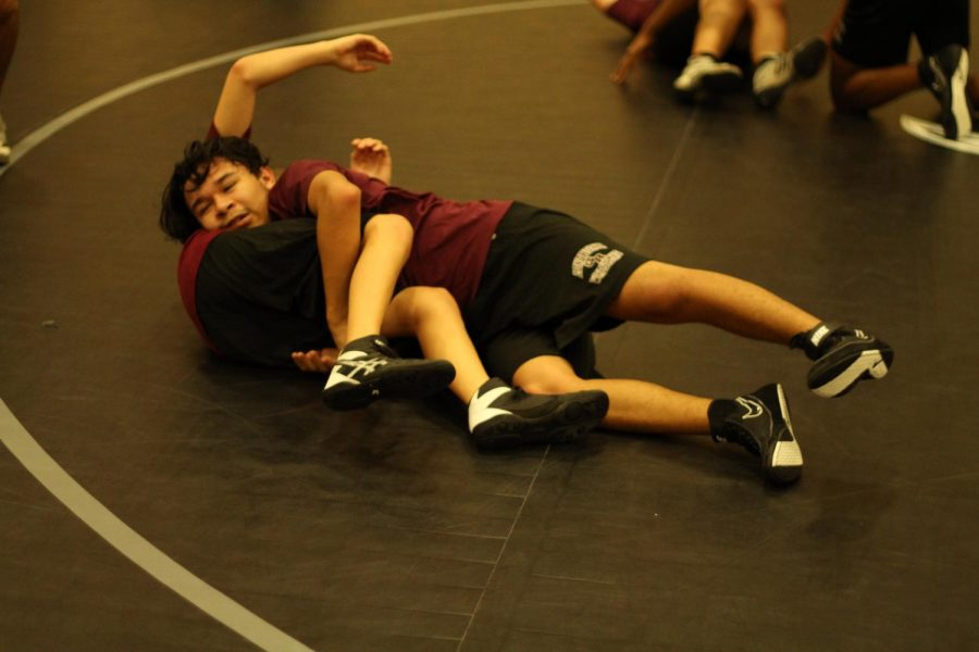 Colby+Duran+gaining+the+upper+hand+and+pinning+his+opponent.+