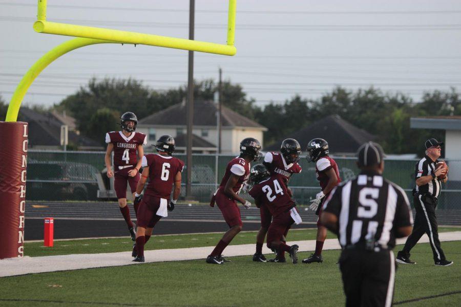 sam miller (12) brett jetton (12) jumping for joy as scoring another touchdown