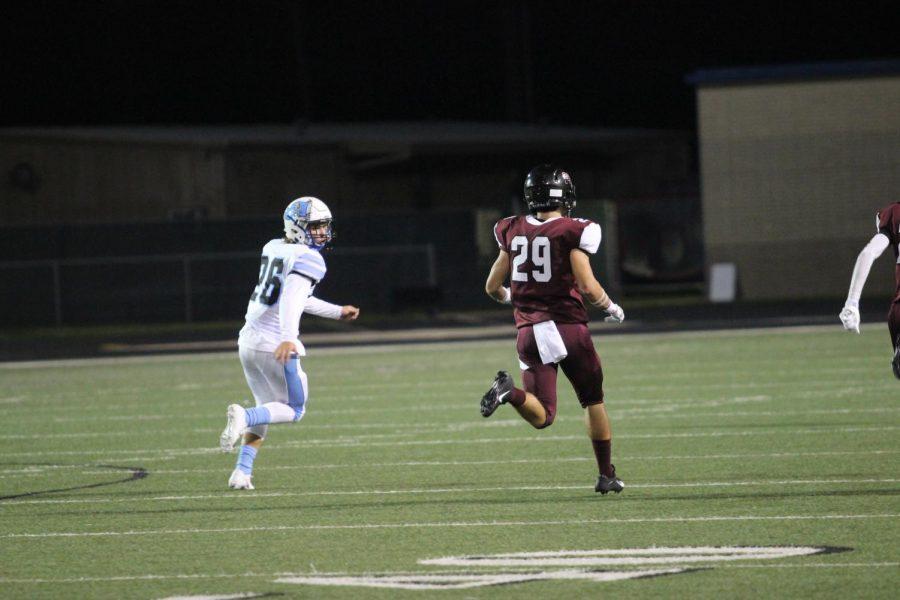Wyatt Jones (10) running past opponent to catch incoming ball
