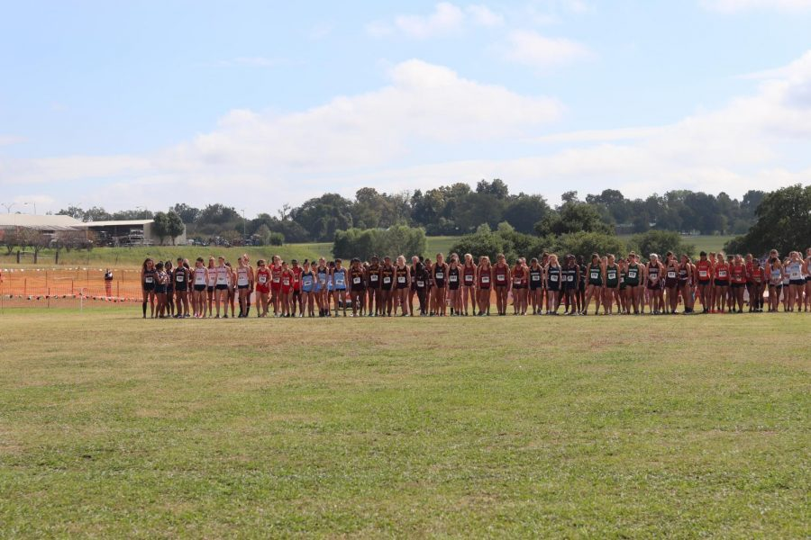 Before the race begins, the George Ranch Varsity Girls are stepping to the line, getting ready for the gun to go off.