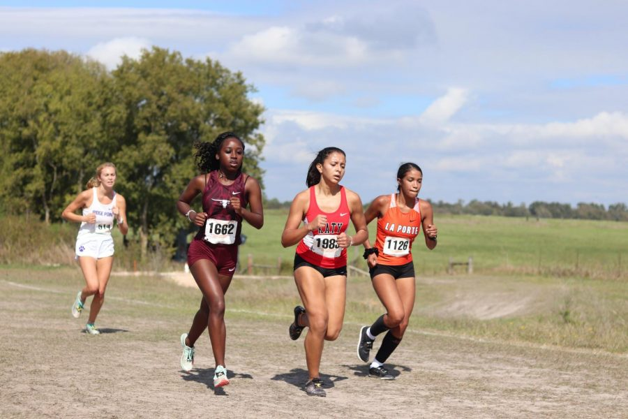 Kianna Stamps (9), speeds up to pass the girls ahead of her as she closes in on her final lap.
