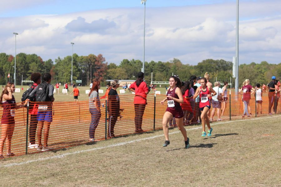 Alyssa Hiekkila (12), finishes strong as she passes another girl before the end.