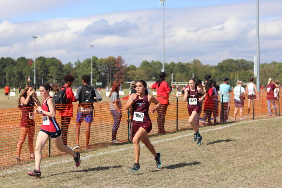 Sydney Delgado (12) and Madison Haldiman (9), competed to the finish line as they worked together to pass up more girls.