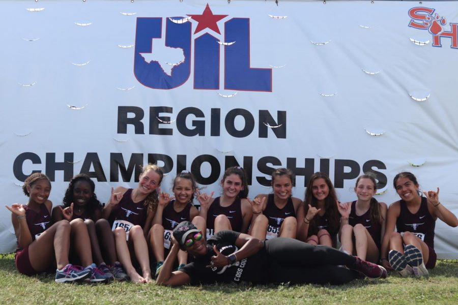From left to right, Ava Curtis (9), Kianna Stamps (9), Britton Bielitz (11), Chantell Maina (12), Coach Dutch, Alyssa Hiekkila (12), Brooke Johnson (12), Jessica Paquette (10), Madison Haldiman (9), and Sydney Delgado (12) competed for 8th place at the Region 3 XC meet.